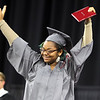 Lowell High graduation. Jahnarae Bradshaw celebrates. (SUN/Julia Malakie)