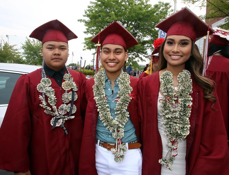 From left, Christian Chea and twins Vannida Chap and Danavan Chap, before Lowell High graduation. (SUN/Julia Malakie)