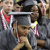 Lowell High graduation. Carlos Agricourt, left, and Blessing Aigbe. (SUN/Julia Malakie)