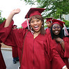 Lowell High graduation. Peace Oguachuba, left, and Felicia Osei, right. (SUN/Julia Malakie)