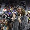 Lowell High graduation. Marijayne Blanton cheers speech of her best friend, salutatorian Ashley Diep. (SUN/Julia Malakie)