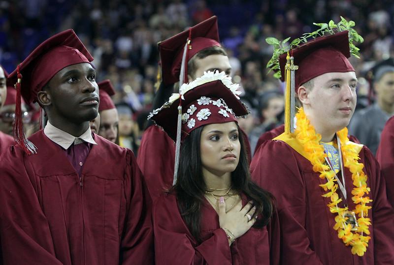 Lowell High graduation. From left, Clevince Bogle, Sabrina Bonilla, and Jason Bourret. (SUN/Julia Malakie)