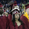 Lowell High graduation. From left, Clevince Bogle, Sabrina Bonilla, and Jason Bourret. (SUN/Julia Malakie)
