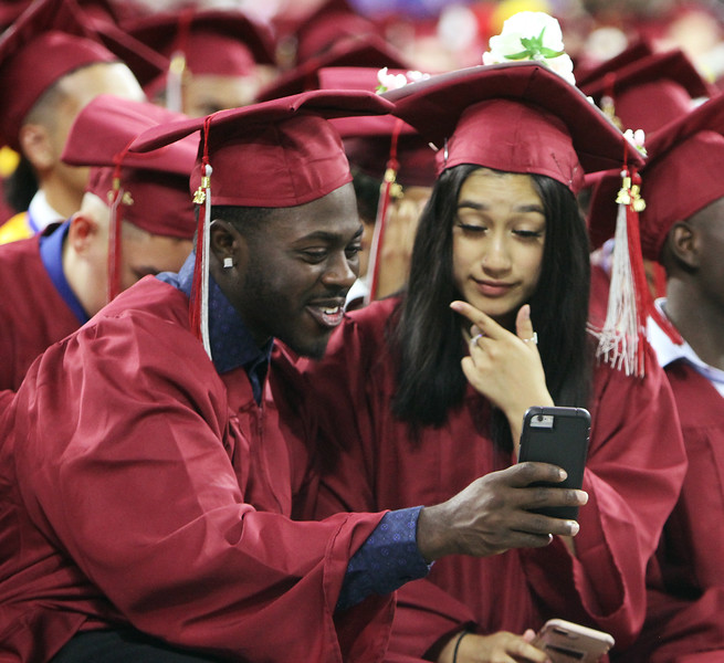 Lowell High graduation. Emil Adodoadji, left, and Karla Aizpurua. (SUN/Julia Malakie)
