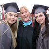 Lowell High graduation. Aliyah Jones, left, Taylor Homen, right, with homeroom teacher Ann Bienvenue. (SUN/Julia Malakie)