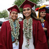 Twins Vannida Chap, left, and Danavan Chap, before Lowell High graduation. (SUN/Julia Malakie)