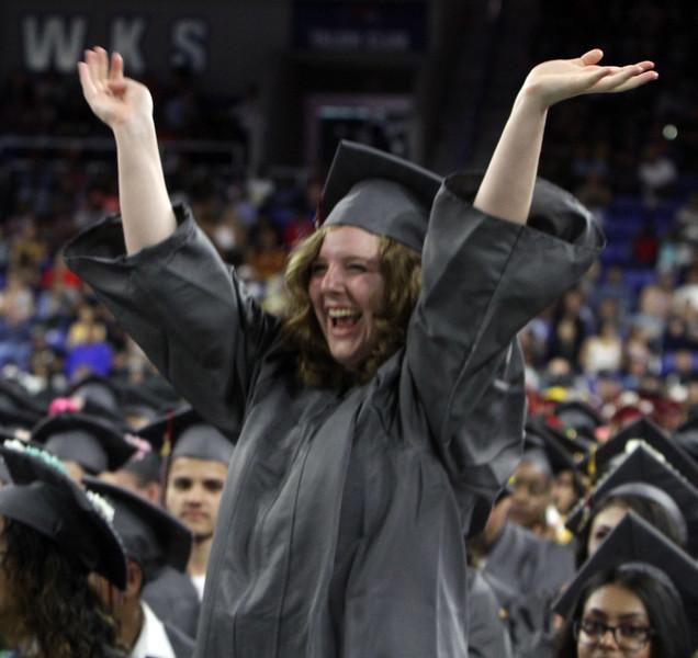 Lowell High graduation. Marijayne Blanton cheers speech of her best friend, salutatorian Ashley Diep. (SUN/Julia Malakie)