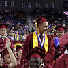 Lowell High graduation. Graduates going into the military are asked to stand. (SUN/Julia Malakie)
