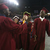Lowell High graduation. Emil Adodoadji, left, and A.J. Boykai, right, celebrate. (SUN/Julia Malakie)