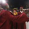 Lowell High graduation. Emil Adodoadji, left, and A.J. Boykai, right, celebrate. (SUN/Julia Malakie)