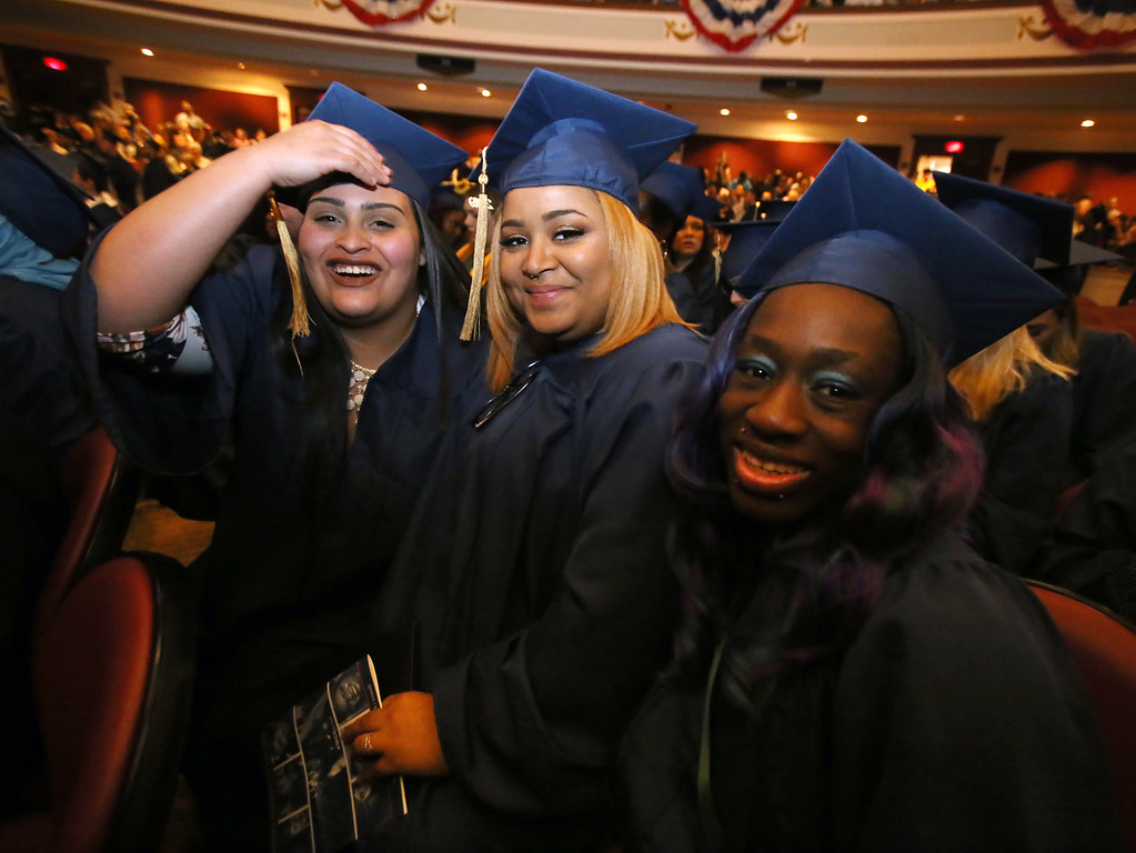 . Middlesex Community College commencement. From left, Eliana Gonzalez, Tyleeah Gonzalez (no relation) and Miracle Martin, all of Lowell, and the only three Certificate Nursing Assistant graduates. (SUN/Julia Malakie)