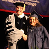Middlesex Community College commencement. Dana Ibrahim of Lowell with president James Mabry.(SUN/Julia Malakie)