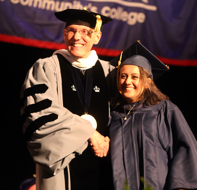. Middlesex Community College commencement. Dana Ibrahim of Lowell with president James Mabry.(SUN/Julia Malakie)