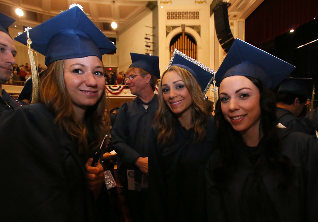 . Middlesex Community College commencement. From left, Krystle Marcaurelle of Hudson, N.H., Katie Hashem of Andover, and Jess Harvey of Tewksbury. (SUN/Julia Malakie)