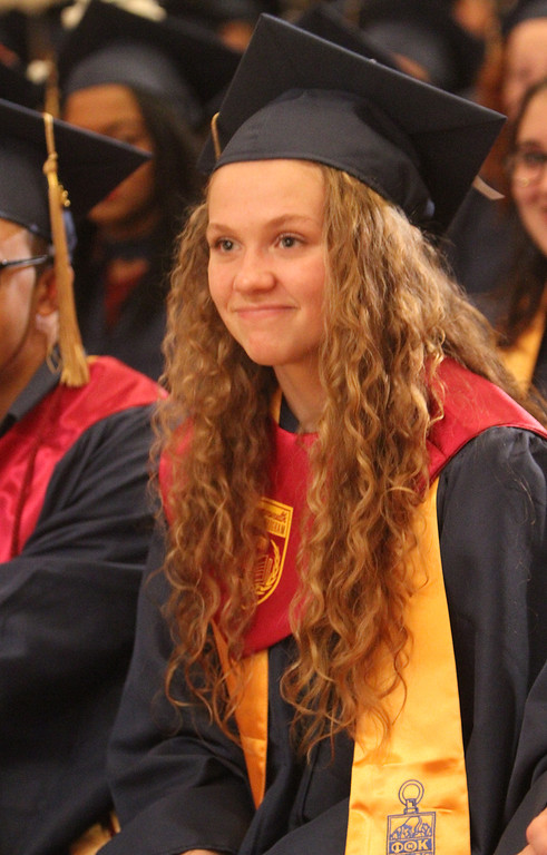 . Middlesex Community College commencement. Brittany Brown of Westford, who started MCC at age 14, looks toward her brother, also a student. (SUN/Julia Malakie)