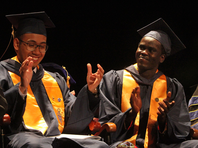 Middlesex Community College commencement. Student speakers Randy Nguyen of Woburn and Biar Kon of Lowell. (SUN/Julia Malakie)