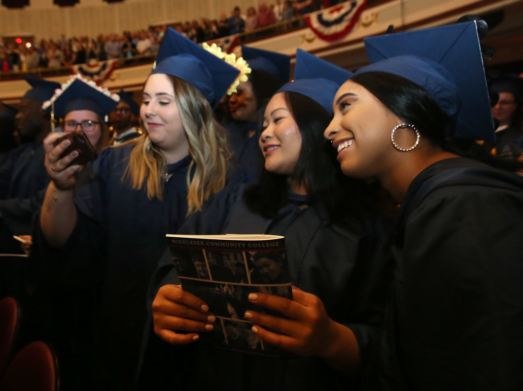. Middlesex Community College commencement. From left, Gabriella DeGrazia of Billerica, Malyvanh Chanthavong of Lowell, and Marleni Castillo of Lawrence. (SUN/Julia Malakie)