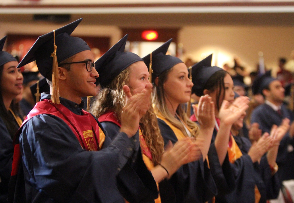 . Middlesex Community College commencement. Student marshals, from left, Juan Breton of Lowell, Brittany Brown of Westford, Jessica Cobleigh of Pepperell and Kaitlin Fung of Acton. (SUN/Julia Malakie)