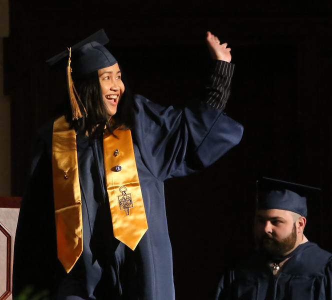 Middlesex Community College commencement. Lina Chap of Lowell waves from the stage. She received an Associate in Science Medical Laboratory Technician. (SUN/Julia Malakie)