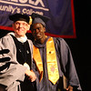 Middlesex Community College commencement. Student speaker Biar Kon of Lowell with president James Mabry. (SUN/Julia Malakie)