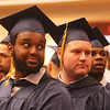 Middlesex Community College commencement. From left, Stephen Gakuya of Lowell, Matthew Downs of Dracut, and David Ayodele of Lowell. (SUN/Julia Malakie)