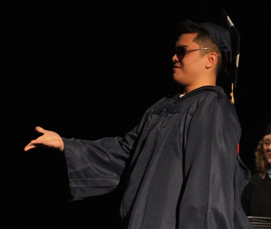 . Middlesex Community College commencement. Anh Bui of Lowell goes up to get his diploma. (SUN/Julia Malakie)