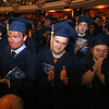 Middlesex Community College commencement. From left Liam Melvin of Newburyport, Nicolas Pace of Stoneham and Sara Robinson of Billerica, as graduates stand to applaud faculty. (SUN/Julia Malakie)