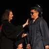Middlesex Community College commencement. Anh Bui of Lowell gets a pat on the shoulder from Pam Flaherty. (SUN/Julia Malakie)