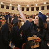 Middlesex Community College commencement. Thania Aguirre of Haverhill waving as graduates enter. (SUN/Julia Malakie)