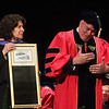 Middlesex Community College commencement. Dean of Advancement Sherri McCormack presents mirror to commencement speaker, Bedford police chief Robert Bongiorno. (SUN/Julia Malakie)