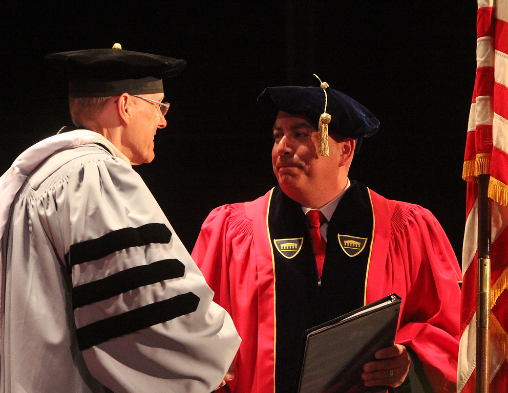 . Middlesex Community College commencement. Commencement speaker, Bedford police chief Robert Bongiorno, right, and president James Mabry.(SUN/Julia Malakie)