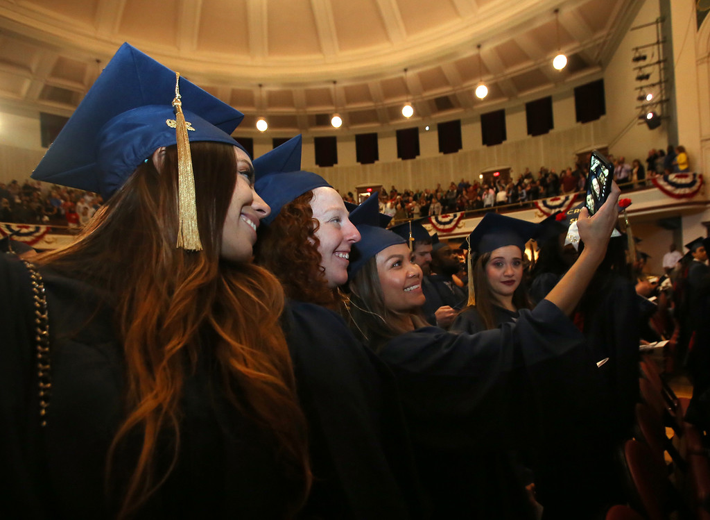 . Middlesex Community College commencement. From left, Alex Doherty of Billerica, Meghan Franey of Billerica, Thary Hang-Ken of Lowell and Amal Hassouna of Lowell. (SUN/Julia Malakie)