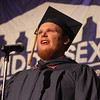 Middlesex Community College commencement. Graduate Tyler Hoyt of Tyngsboro sings the National Anthem. (SUN/Julia Malakie)