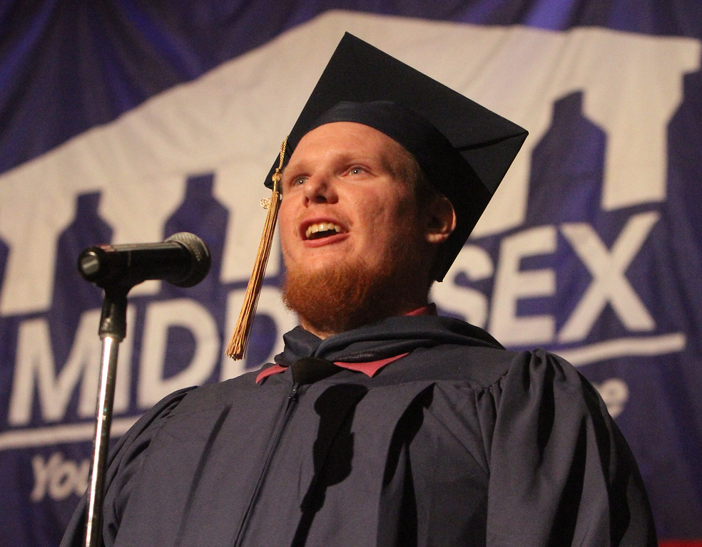 . Middlesex Community College commencement. Graduate Tyler Hoyt of Tyngsboro sings the National Anthem. (SUN/Julia Malakie)