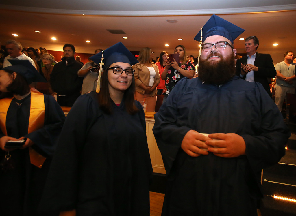 . Middlesex Community College commencement. [Not sure of order of IDs] (SUN/Julia Malakie)