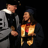 Middlesex Community College commencement. Mai Nagabayashi of Lowell shakes hands with president James Mabry after receiving her degree. (SUN/Julia Malakie)