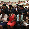 Middlesex Community College commencement. Relatives of posthumous graduate Latoya Chikakayi, who suffered a fatal car accident in Zimbabwe. Seated from left, her mother Memoril Tom, her aunt Greta Chikakayi, grandmother Angela Tom, and sister Taradzwa Chikakayi, who accepted the degree on her behalf, all of Lowell. (SUN/Julia Malakie)
