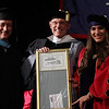 Middlesex Community College commencement.  From left, Dean of Advancement Dennis Malvers, president James Mabry, presenting the Distinguished Alumni Award to Carla Rojo, who spoke. (SUN/Julia Malakie)