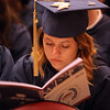 Middlesex Community College commencement. Meaghan O'Beirne of Lowell studies the program.  (SUN/Julia Malakie)