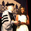 Middlesex Community College commencement. Taradzwa Chikakayi of Lowell accepts a posthumous degree from president James Mabry on behalf of her sister Latoya Chikakayi, who suffered a fatal car accident while visiting Zimbabwe. (SUN/Julia Malakie)