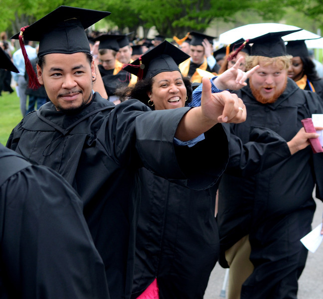 Montgomery County Community College Class of 2014 members show their entusiasm during the school's Forty -Seventh Commencement on  Thursday  May 15 , 2014.  Photo by Mark C Psoras/The Reporter