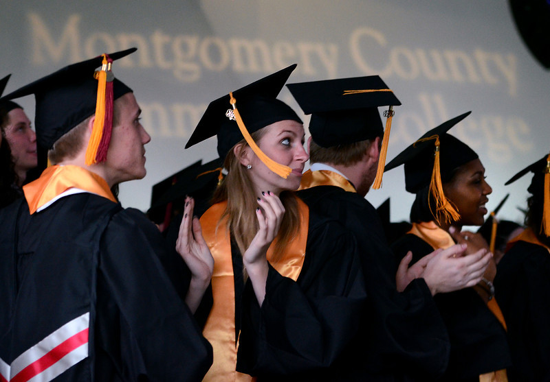 Montgomery County Community College Class of 2014 members applaud during a moment of the school's Forty -Seventh Commencement on  Thursday  May 15 , 2014.  Photo by Mark C Psoras/The Reporter