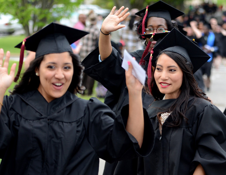 Montgomery County Community College Class of 2014 members wave to friends and family during the Processional of the school's Forty -Seventh Commencement on  Thursday  May 15 , 2014.  Photo by Mark C Psoras/The Reporter