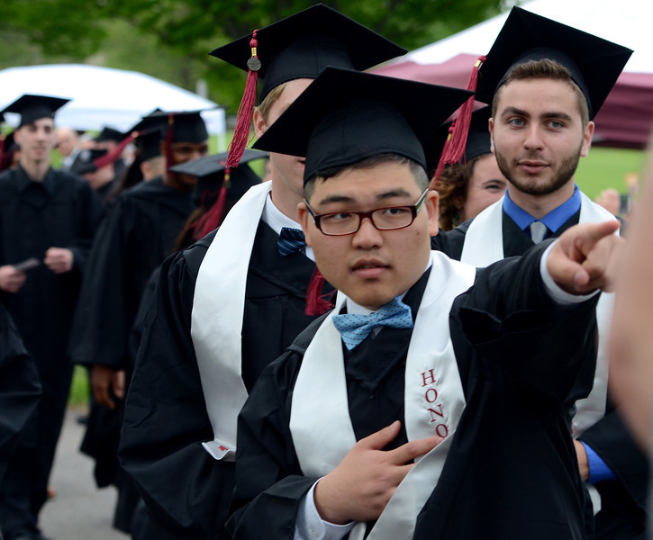 Montgomery County Community College Class of 2014 members show their entusiasm during the Processional of the school's Forty -Seventh Commencement on  Thursday  May 15 , 2014.  Photo by Mark C Psoras/The Reporter