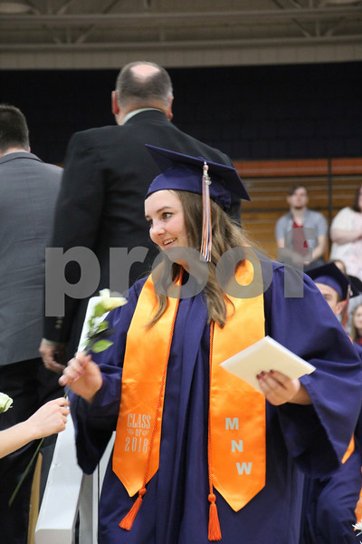 -Messenger photo by Andy Johnson<br /> <br /> Cara Dewall receives her graduation rose Sunday afternoon during commencement at Manson Northwest High School.