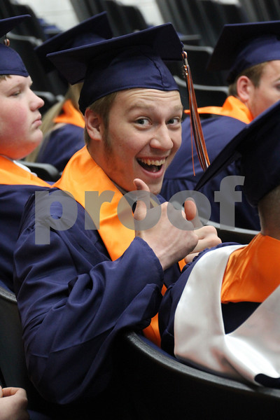 "-Messenger photo by Andy Johnson<br /> <br /> Jamison Schriever gives graduation day the thumbs up Sunday afternoon at the Manson Northwest High School graduation. ""No matter what life throws at you, enjoy what you can,"" he said."