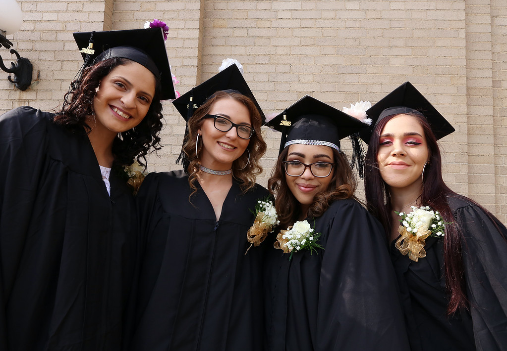 . Middlesex Charter graduation at MRT. From left, Erica Clark of Dracut, Cassidy Murphy of Lowell, Vididiana Gonzalez of Methuen, and Sophia Gallagher of Chelmsford. (SUN/Julia Malakie)