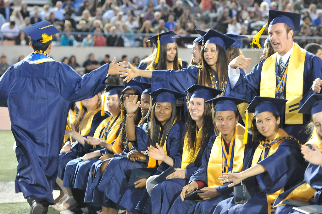 . LONG BEACH - 06/12/2014 - (Mark Savage) Millikan High School Graduation at Veterans Memorial Stadium. Thomas Luka lifts his friend Brian Bowser after he receives his diploma.