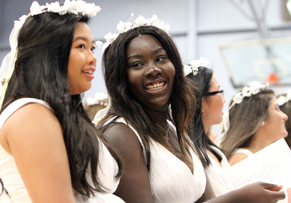 . Notre Dame Academy  graduation. Dennise Annan of Lowell, left, and Annie Kelley of Lowell. (SUN/Julia Malakie)