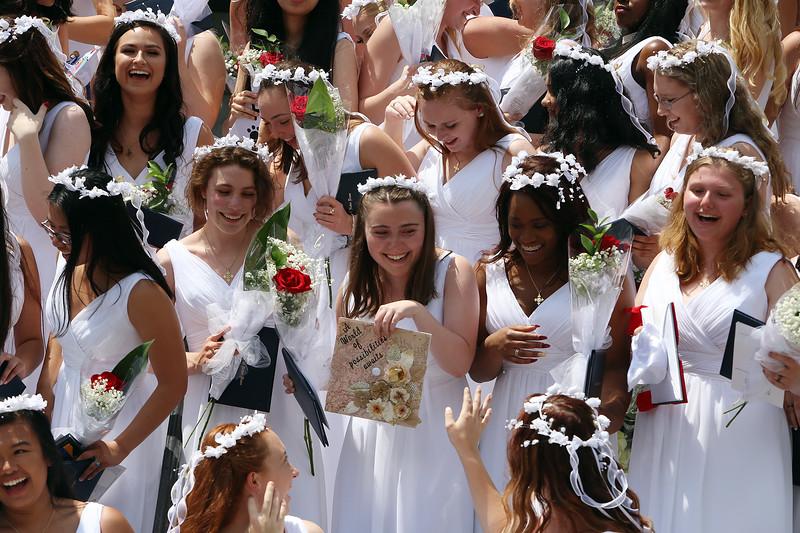 Notre Dame Academy graduation. Graduates laugh after the toss of caps. (SUN/Julia Malakie)